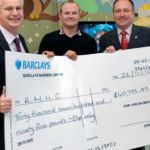 Shawn-Kevin-Handing-Over-Check-to-RMHC-in-Birmingham-.jpg